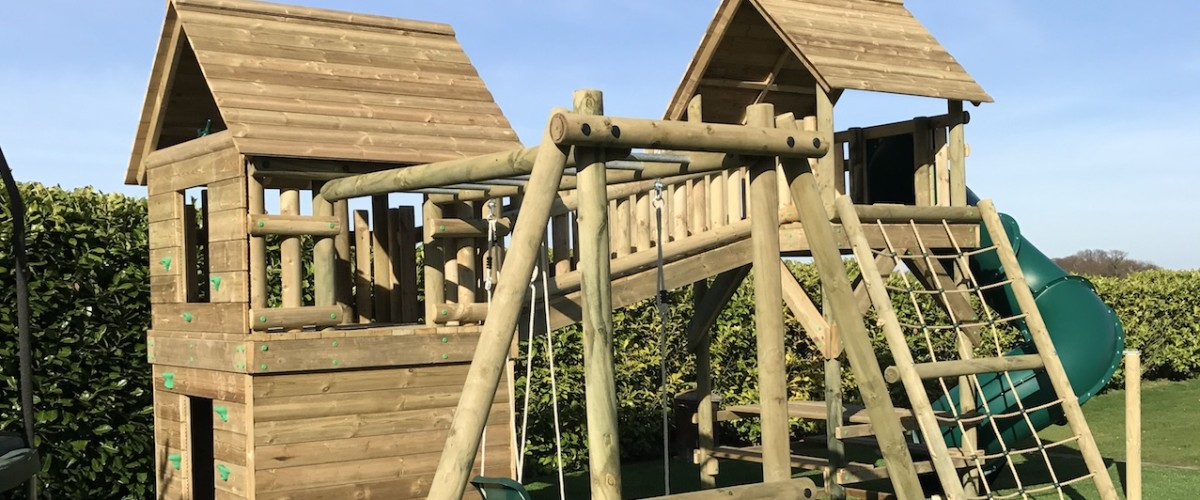 Double-Tower-with-Monkey-Bar-Swing-Set-1278x530