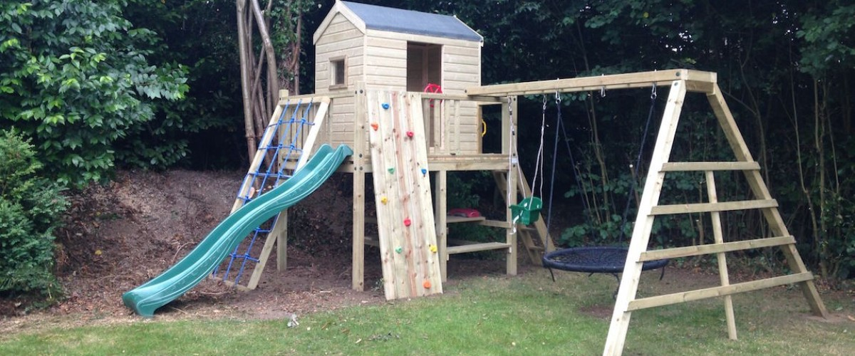 Fun-House-with-Slide-Cargo-Net-Climbing-Wall-and-Swing-Extension-GPHNXCW-S-banner