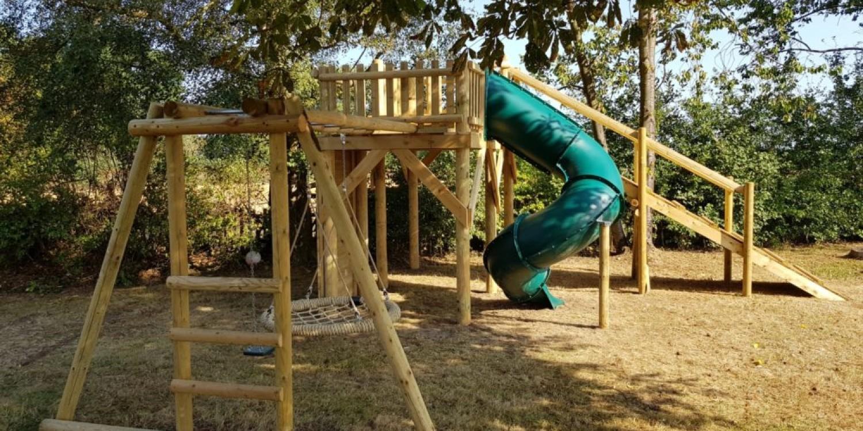 basket monkey bar swing set attached to zip wire platform