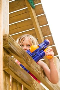 water fight in wooden climbing tower