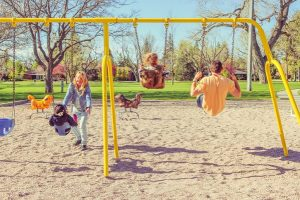 Family on Swings Together
