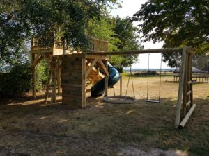 back of zip wire play platform with swing set